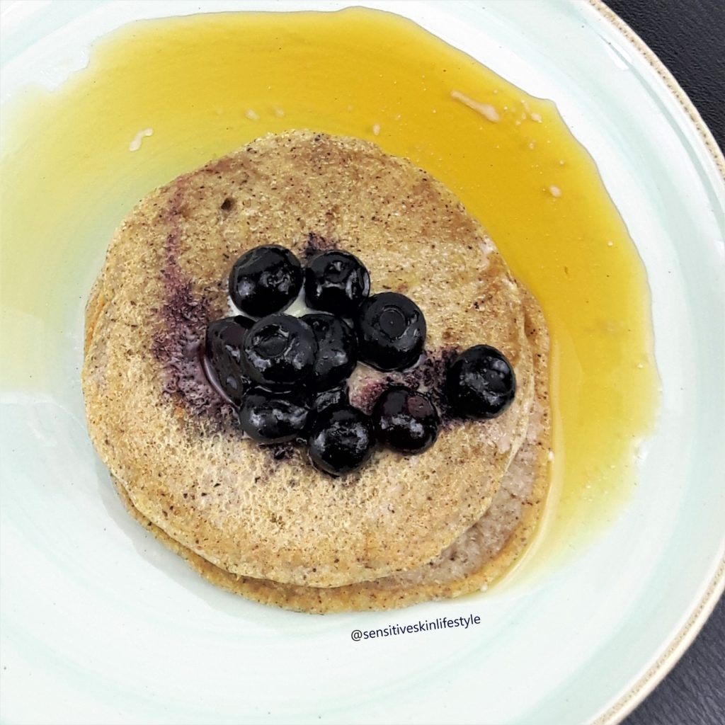 Top view photo of Catherine's home-made buckwheat pancakes with maple syrup and blueberries