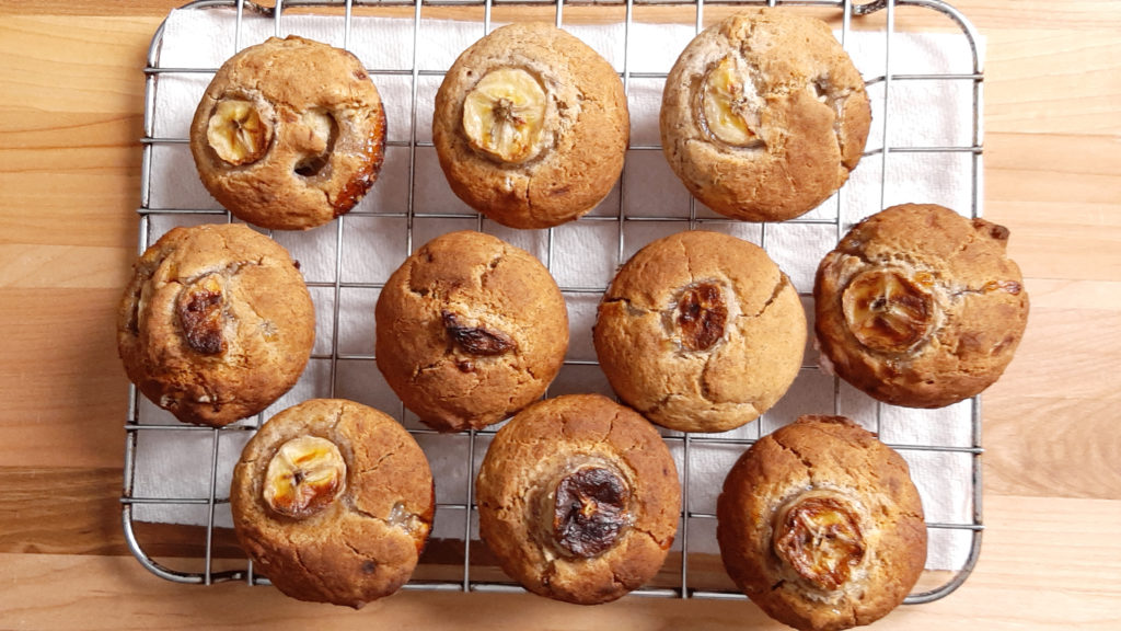 gluten free and vegan banana buckwheat muffins on a cooling rack